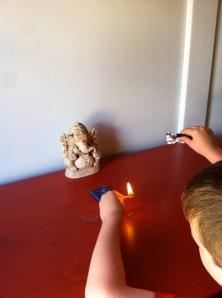 B practices lighting incense
